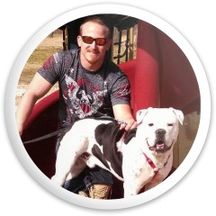 A man and his dog Dynamic Discs Fuzion Defender Driver Disc